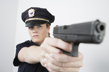 View of a police woman aiming with pisol.
