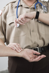 Emergency Medical Service officer checking pulse