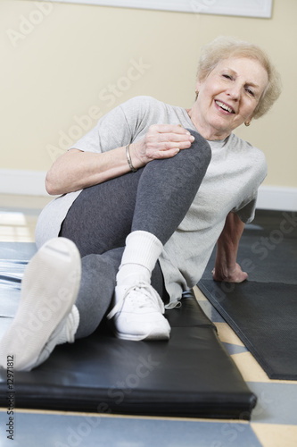 Portrait of senior woman exercising in the gym.