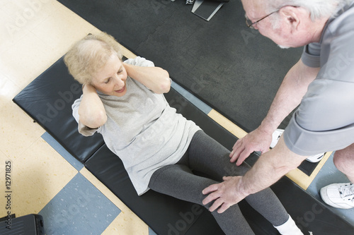 Senior couple exercising in the gym.