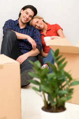 Couple sitting in new home