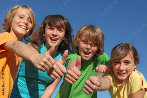 happy smiling group of confident children with thumbs up