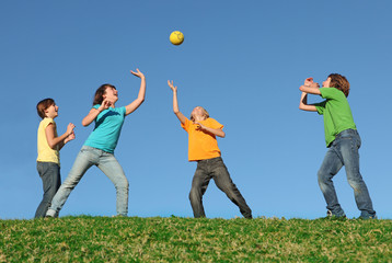 group of fit healthy active kids playing ball
