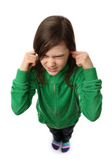 Girl stops ears, standing isolated on white background