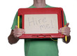 Man holding magnetic drawing board with message.