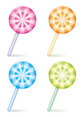 Set of four differently coloured striped candies