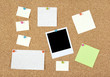 Post-it notes, papers and photo on a corkboard