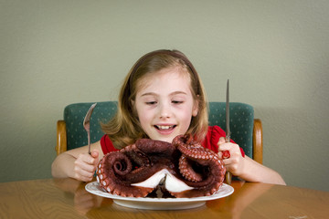 Child eating Octopus Dinner