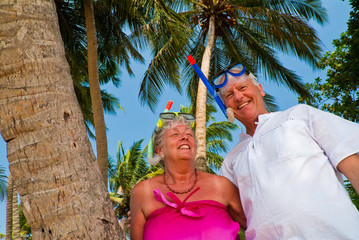 Happy mature couple with snorkeling gear