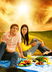 Young couple at romantic picnic