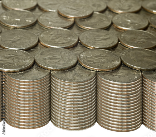 Stacks of quarters with golden tones
