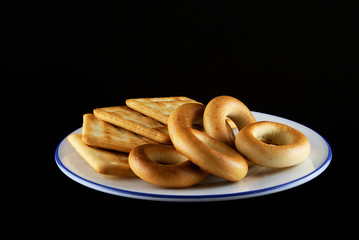 Barankas and cookies on white plate with blue border.