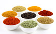bowls of spice powders on white background