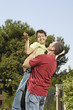 father embrace son in urban park