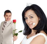 attractive boyfriend offering a rose to his bride poster