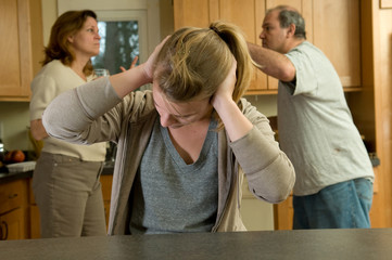 Teenage daughter covers ears while parents fight