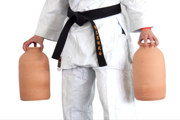 Martial art stance, man balanced in karate  kata with  vases