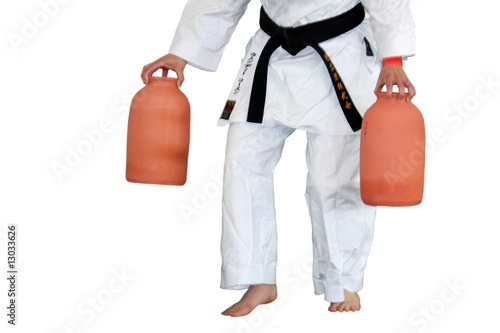 Martial art stance, man holding balance with  vases