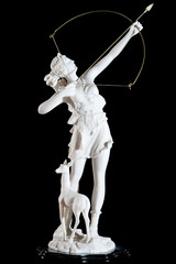 Classic white marble statuette of Artemis isolated on black