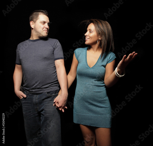 Young couple isolated on black