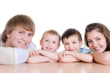 faces of members of young loving family poster