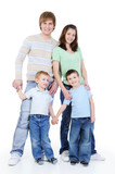 full-length portrait of young happy family poster