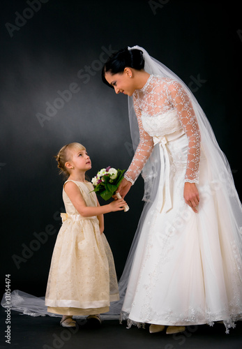 Bride giving flowers to bridesmaid