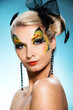 Beautiful woman with butterfly face-art