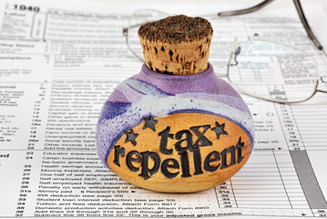 Corked bottle of tax repellent