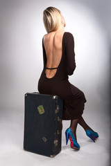 beauty woman sit on old case