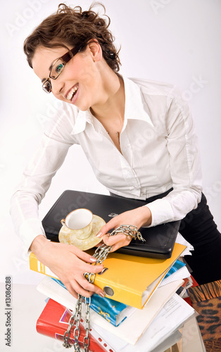 Smiling businesswoman with a package of books