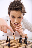Young chess player losing a game poster