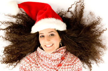 hispanic female with christmas hat and lying with open hairs