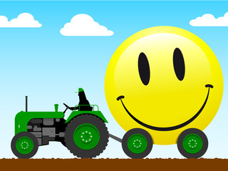 Tractor pulling a huge smiley face