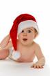 Kleines Kind baby mit Weihnachtsmann Mütze