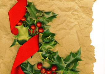 Traditional Christmas background with holly and red bow