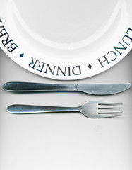 .Knife and fork with white plate