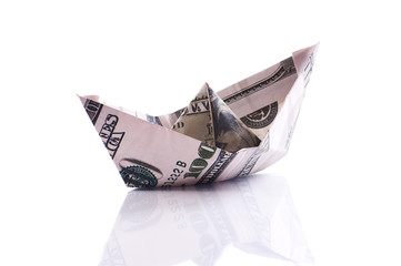 paper boat from dollar banknote on white