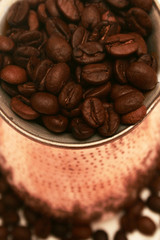 Cezve with coffee beans.