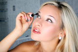 girl in bathroom with liquid mascara poster