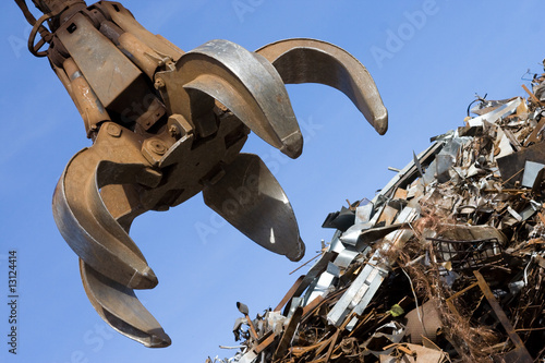 canvas print picture crane grabber up on the rusty metal heap
