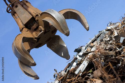 crane grabber up on the rusty metal heap - 13124414