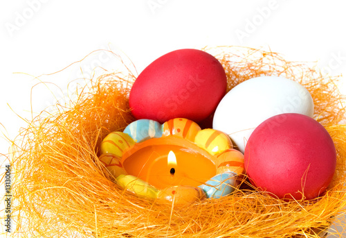 Eggs and candle in a small nest