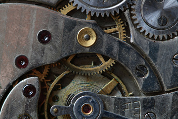 Close-up of old watch mechanism as background