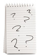 Six Question Marks On Notebook