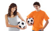 Couple of teenagers with soccer balls a over white background .C