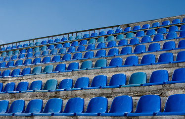 Empty seat rows of blue