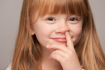 Adorable Red Haired Girl Picks Her Nose