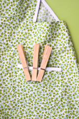 An Amish childs apron with clothes pins