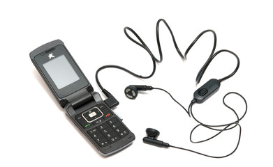 Close up of mobile telephone with headset